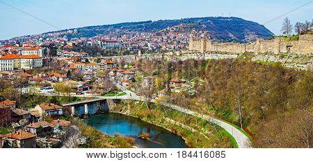 The fortress walls of Tsarevets castle and Yantra river. Veliko Tarnovo city, Bulgaria.