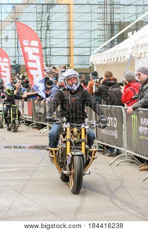 St. Petersburg Russia - 15 April, The biker rides along the spectators,15 April, 2017. International Motor Show IMIS-2017 in Expoforurum. Sports motorcycle show of bikers on the open area.