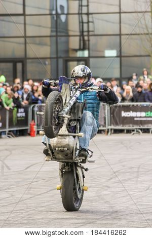St. Petersburg Russia - 15 April, Motoshow for the audience,15 April, 2017. International Motor Show IMIS-2017 in Expoforurum. Sports motorcycle show of bikers on the open area.