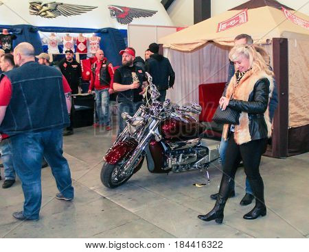 St. Petersburg Russia - 15 April, Visitor of the Motor Show,15 April, 2017. International Motor Show IMIS-2017 in Expoforurum. Visitors and participants of the annual moto-salon in St. Petersburg.