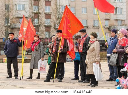 Kirishi, Russia - 1 May, Elderly people with flags,1 May, 2017. People at the May demonstration and rally in the Russian provincial government.