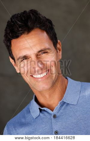 Handsome Older Man Smiling With Blue Shirt