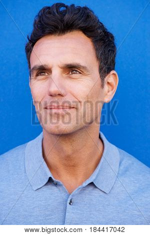 Older Man Looking Away Against Blue Background