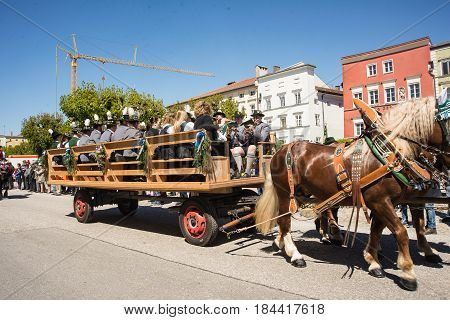 Tittmoning,Germany-April 30,2017: A carriage with a bavarian brass band drives by at the Annual St.George's parade