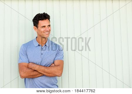 Cool Older Man Smiling With Arms Crossed