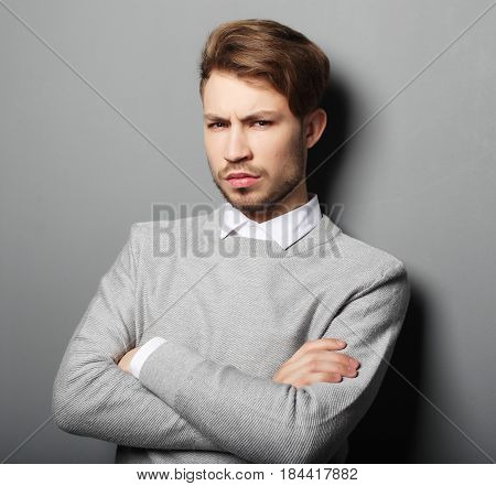lifestyle, business and people concept: Sad businessman over grey background