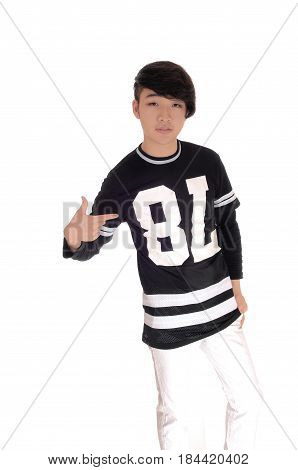A handsome young Korean teenager standing in a black t-shirt pointing his finger at himself isolated for white background.
