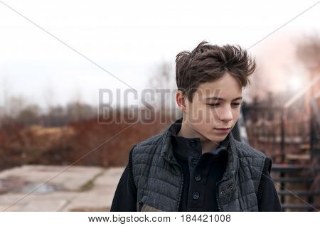 serious young man Standing by the stairs in the evening