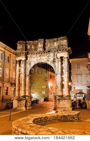 Ancient Roman triumphal arch in Pula Croatia - Arch of the Sergii also know as Golden Gate - translation from croatian