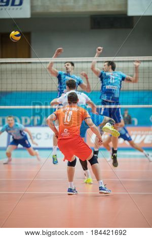 MOSCOW - NOV 5, 2016: Players jump near net at volleyball game Dynamo (Moscow) and Ural (Ufa) in Palace of Sports Dynamo