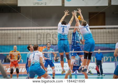 MOSCOW - NOV 5, 2016: Players near net at volleyball game Dynamo (Moscow) and Ural (Ufa) in Palace of Sports Dynamo