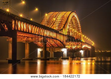 banghwa bridge at night over the han river in seoul, south korea