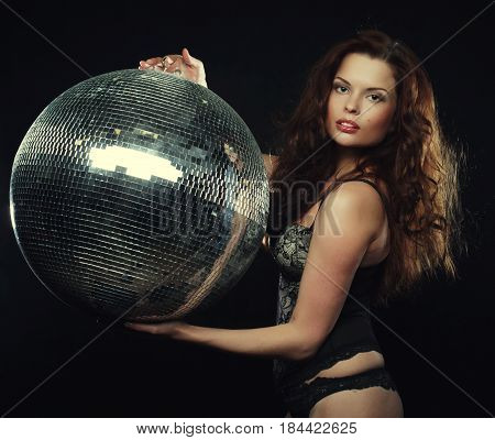 dancer redhair girl  with disco ball over dark background poster