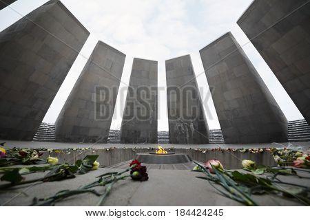 YEREVAN, ARMENIA - JAN 5, 2017: Flowers are on floor in Memorial complex Tsitsernakaberd, dedicated to genocide of armenians in 1915