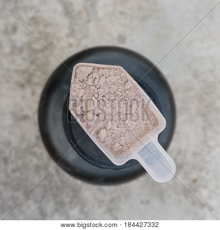 close up of whey protein scoop. Sports nutrition food