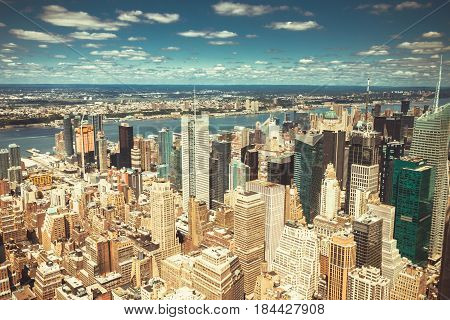 New York City Manhattan skyline aerial view with skyscrapers Hudson and clouds sky.