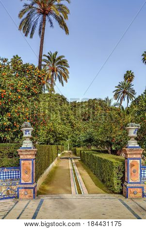 Decorative alleyway in garden in Alcazar of Seville Spain