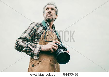Low Angle View Of Nature Photographer Outdoor On Overcast Day.