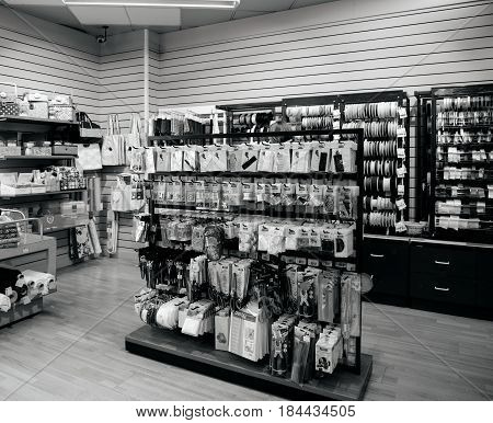 STRASBOURG FRANCE - APR 27 2017: Black and white interior of Textile Tissue Fabric shop with multicolored and diverse accessories for sewing tools and accessories and Cornice for curtains