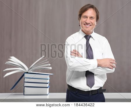 Mature man and books on background