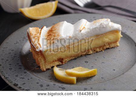 Lemon pie with meringue on a plate