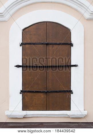 Window Shut With Wooden Shutters
