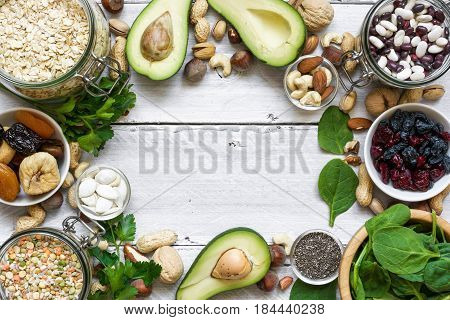 magnesium reach food on white wooden table. healthy food. top view with copy space