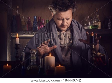 the portrait of a sorcerer with candles