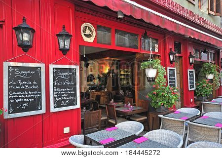 ANNECY FRANCE - AUGUST 22 2015: Exterior of savoyard restaurant in old town of Annecy on August 22 2015. Annecy is a capital of Haute Savoie province France.