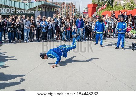 AMSTERDAM, NETHERLANDS - APRIL 31, 2017 - The Ajax Amsterdam breakdancing group performing in the city