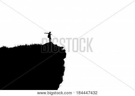 Black and white silhouette background of woman tourist standing arms outstretched happy with success on peak mountain near the cliff at Phu Chi Fa Viewpoint in Chiang Rai Province Thailand