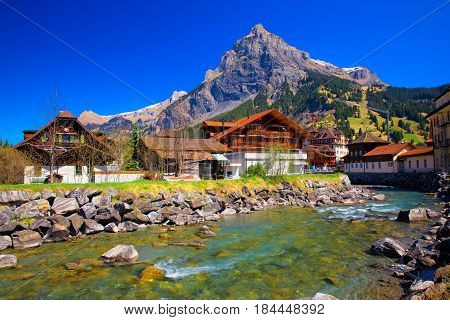 Colorful Wooden Houses With Flowers In Kandersteg Village