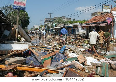 People Walking On The Debris After The Tsunami At Hikkaduwa