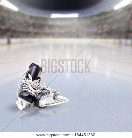 Hockey Skates On Ice Of Crowded Arena
