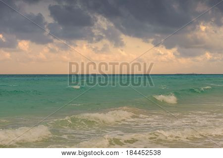 Beautiful  seascape with dramatic sky colorful clouds and sea