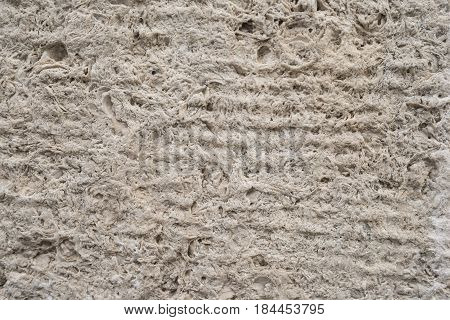 Old unpolished stone wall with grain surface, abstract background. Perfect for background