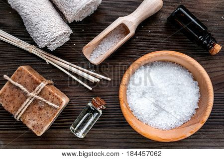 bathroom salt and natural soap for spa set on wooden background top view