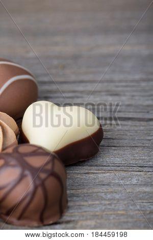 Delicious chocolate candies on wooden background,fine luxury dessert
