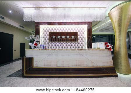 YEREVAN, ARMENIA - JAN 6, 2017: Reception with timezone clocks in Hotel National, it is modern hotel, member of Luxury Group