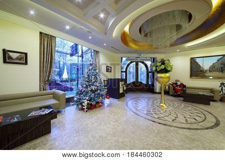 YEREVAN, ARMENIA - JAN 5, 2017: Empty hall with christmas tree in Hotel National, it is modern hotel, member of Luxury Group