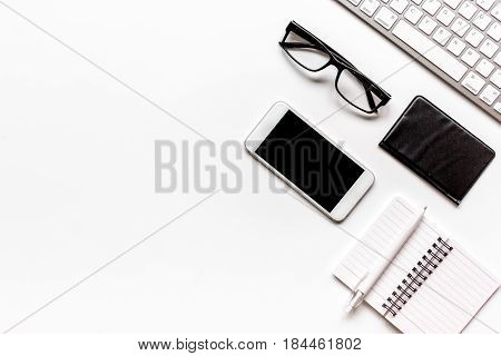 Workspace with keyboard and mobile on office desk white background top view mock up