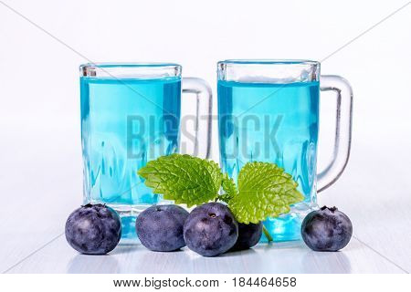 Liqueur of blueberries with fresh berries