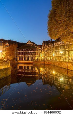 Petit France medieval district of Strasbourgnight scene with reflections, Alsace France