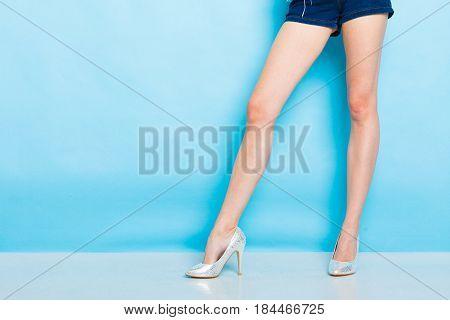 Female Legs In Silver High Heels Shoes
