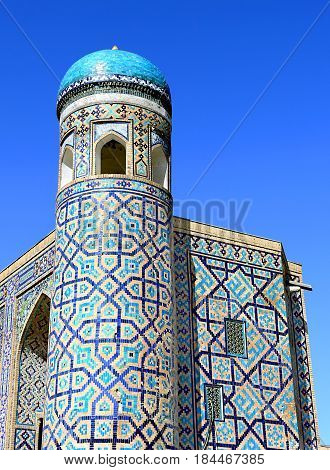 Old-time central asian building with small turret