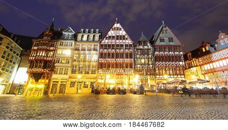 Frankfurt am Main, Germany - April 19, 2013: Half-timbered houses of Romer Square in Frankfurt am Main at night. Wide angle shot