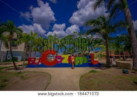 COZUMEL, MEXICO - MARCH 23, 2017: Plaza located in dowtown in the colorful Cozumel. with a colorful informative sign.