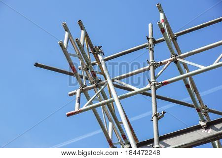 metal scaffolding in building and blue sky background .