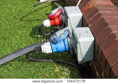 An electric socket timer with cord attached. This one is used outdoors in damp weather which might present a safety issue. Water drops on casing