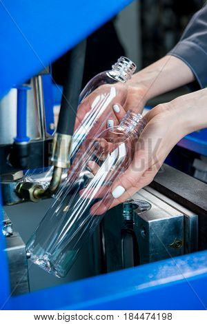 Plastic bottle making process at a water factory